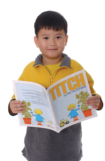 Asian boy reading