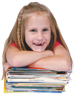 Reading Recovery girl student with stack of books